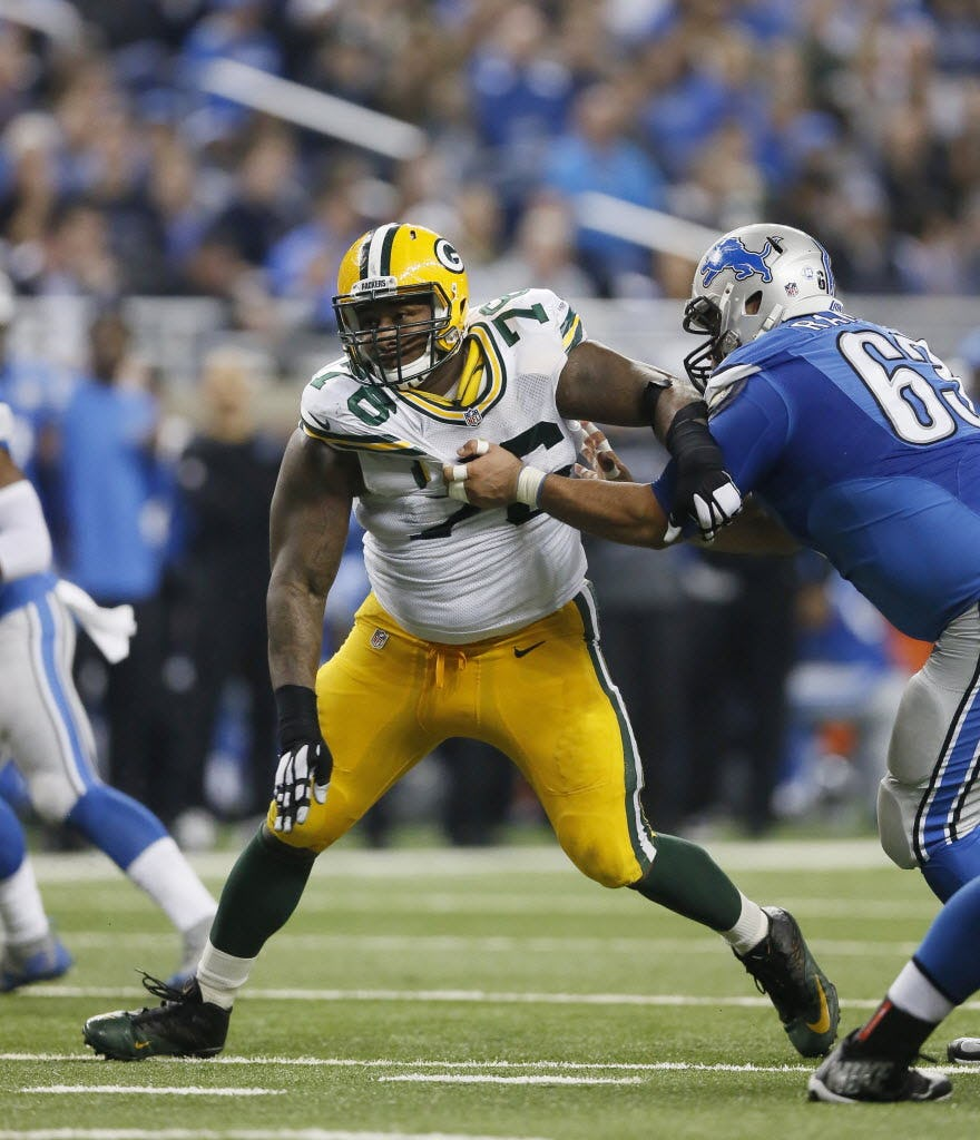 Green Bay Packers defensive end Mike Daniels (76) goes up against Detroit Lions guard Manny Ramirez (63) during the first half of an NFL football game, Thursday, Dec. 3, 2015, in Detroit. (AP Photo/Duane Burleson)