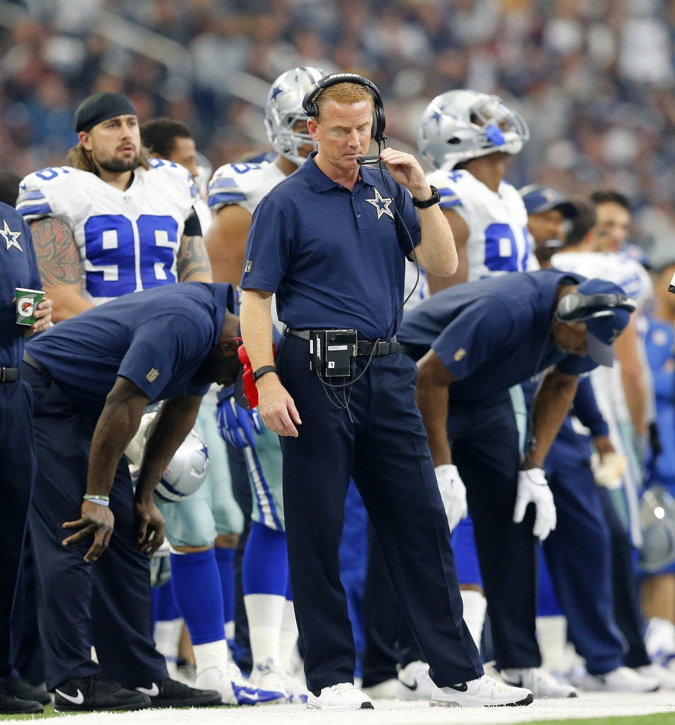 At times, the Dallas Cowboys staff, including head coach Jason Garrett (center), couldn't bear to watch their offense play in the fourth quarter against the Washington Redskins at AT&T Stadium in Arlington, Texas, Sunday, January 3, 2016. The Cowboys lost 34-23.
