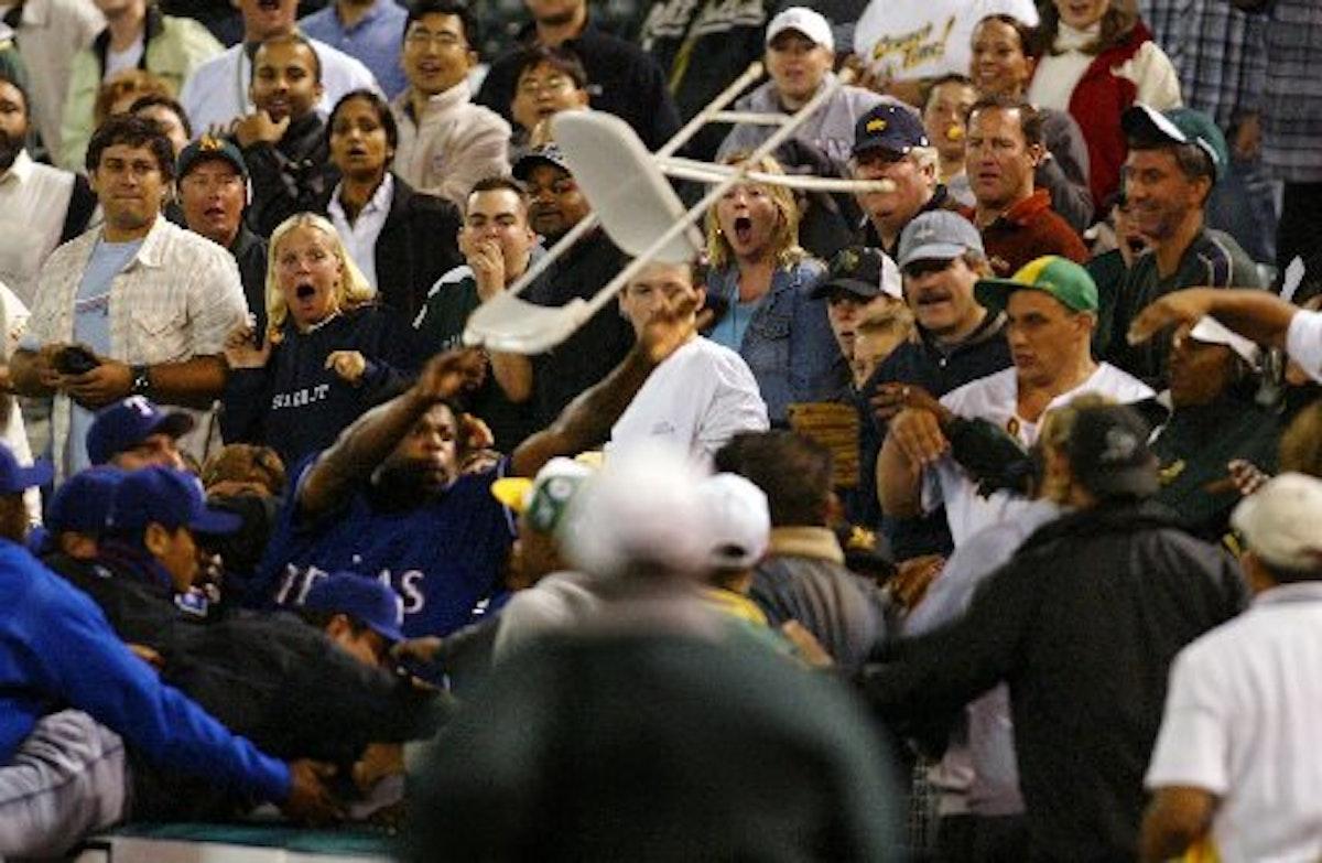 1463443538-rangers-athletics-fan-fight