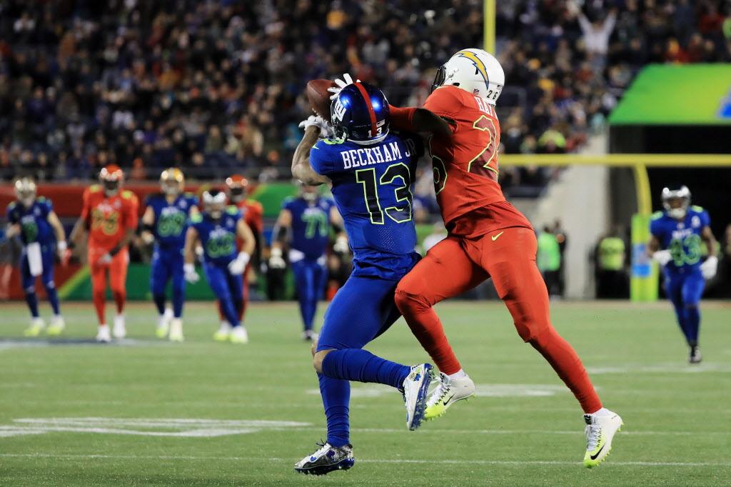 Dallas Cowboys  Photos  Zeke wrangles a fan on the field  see Dak Prescott 88d30db10