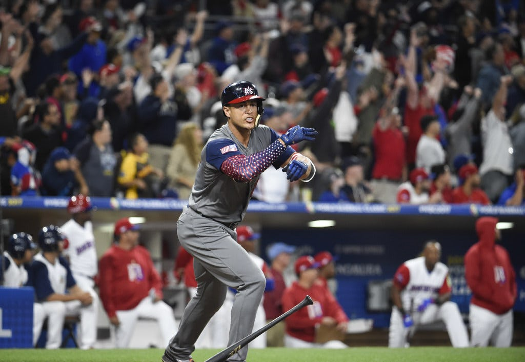 SAN DIEGO, CA - MARCH 18: Giancarlo Stanton #27 of the United States celebrates after hitting a two run home run during the fourth inning of the World Baseball Classic Pool F Game Six between the United States and the Dominican Republic at PETCO Park on March 18, 2017 in San Diego, California.  (Photo by Denis Poroy/Getty Images)