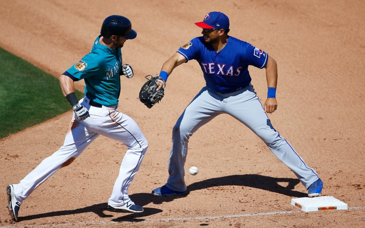 1490632065-rangers-mariners-spring-baseball