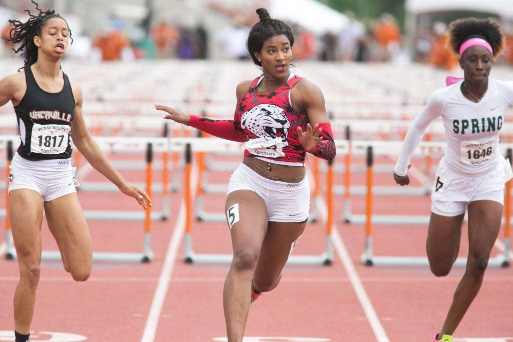 Mesquite Horn's Kaylor Harris, center, takes first in the girls 100 meter hurdles with a time of 13.44 at the 2017 Texas Relays at Mike A. Myers Stadium at the University of Texas at Austin, Texas on April 1, 2017. (Julia Robinson/Special Contributor)