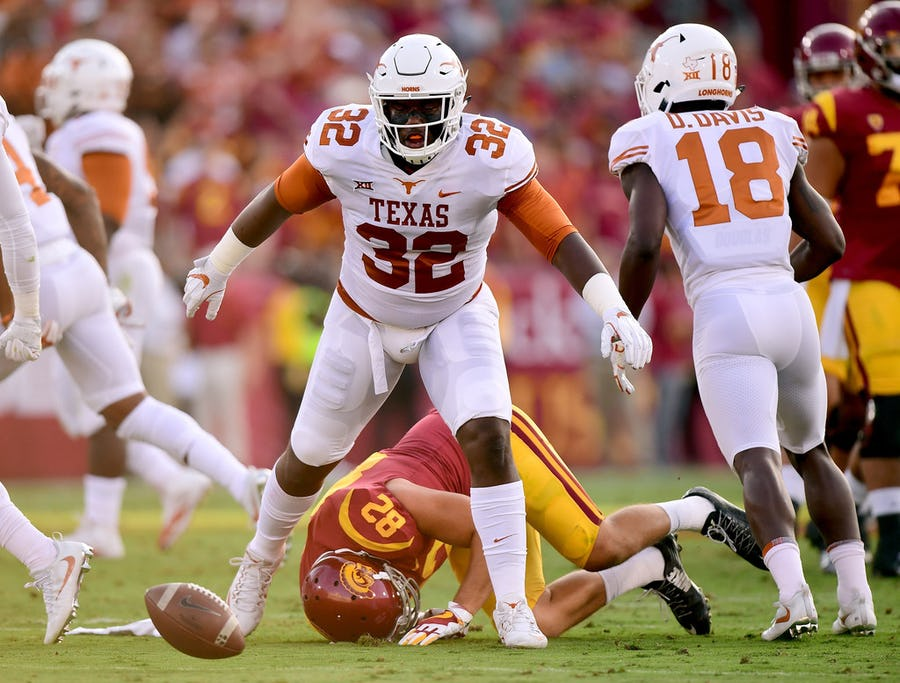 3 takeaways from Texas' player availability, including Malcolm Roach's '32' jersey taking on a new meaning and lessons learned from last year's season opener | SportsDay