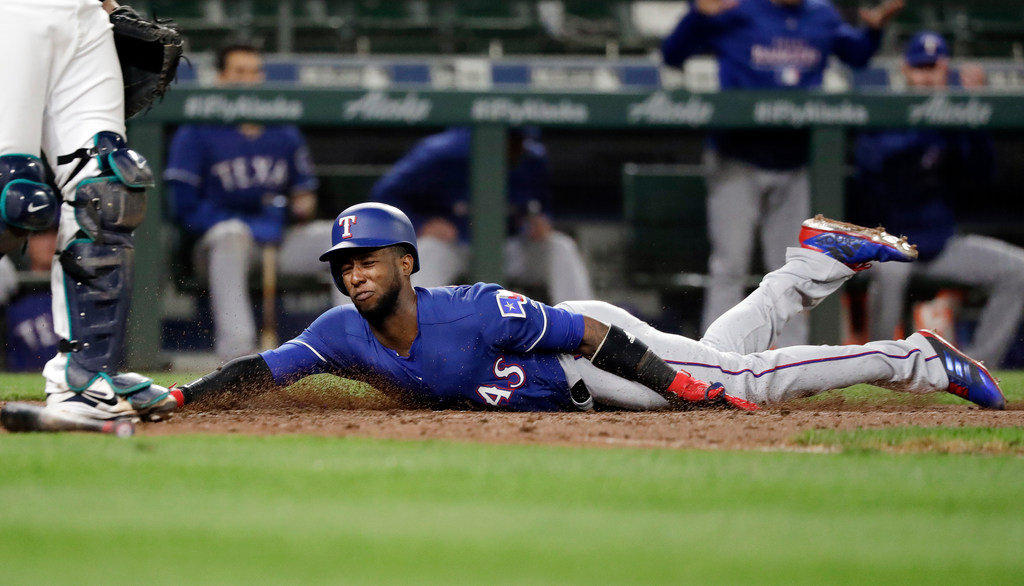 Rangers fail to close out Mariners in extra innings
