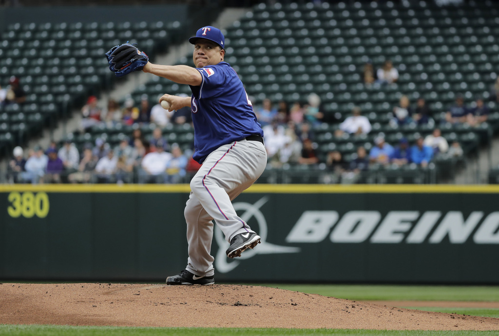 Rangers top Mariners 5-1 behind big day from Bartolo Colon, four-run ninth inning