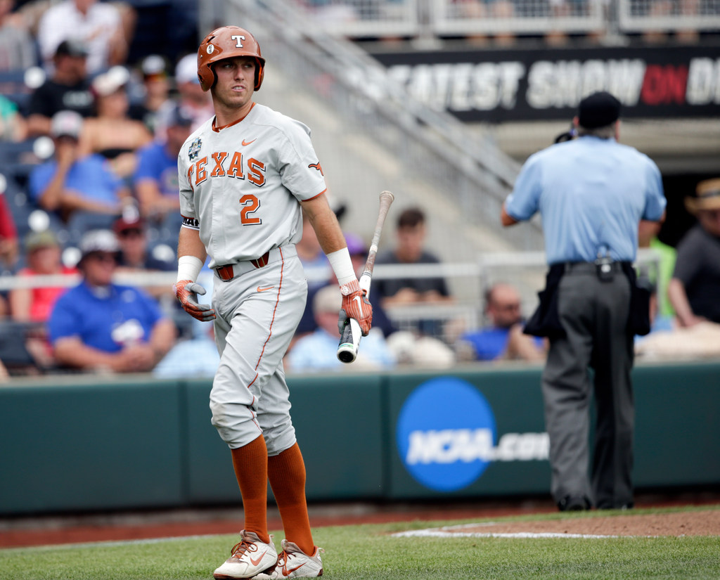 Texas falls to Arkansas in College World Series opener after nearly three-hour rain delay