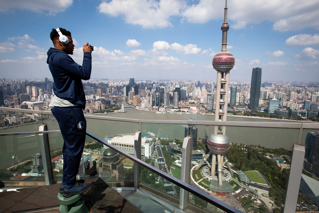 Towering over Shanghai, Mavericks mix in pleasure, business