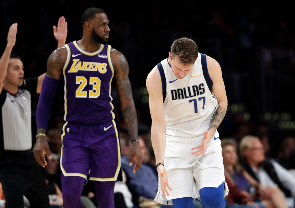 5e8eeae2ab6 Dallas Mavericks: Mavericks didn't get the win, but Luka Doncic got a  parting gift from Lakers superstar LeBron James | SportsDay