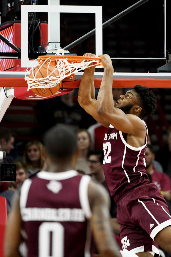 Texas A&M grinds out elusive road win over Arkansas, 87-80, behind another pivotal bench performance from Josh Nebo